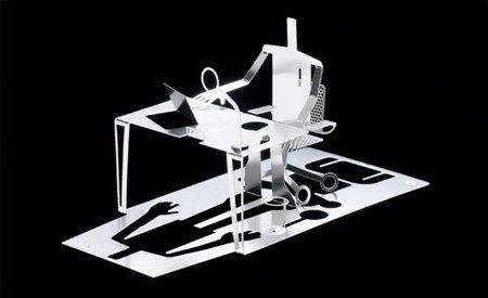 скульптура из визитной карты человек за столом